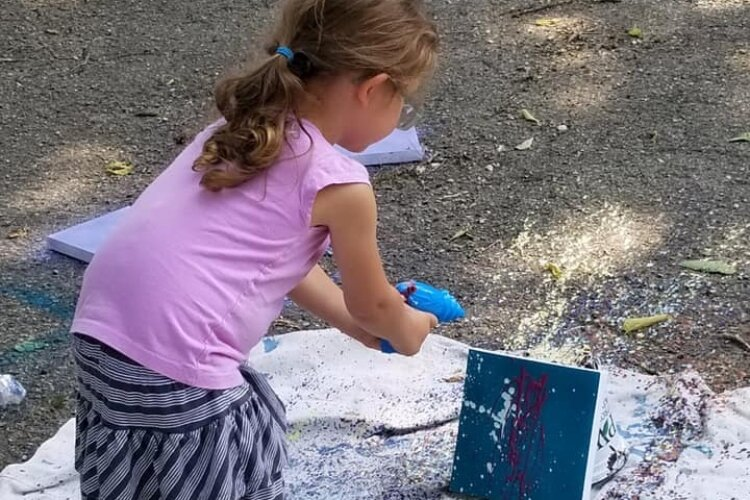 A recent $5 Art lesson included kids using paint-filled squirt guns to make designs on canvas.