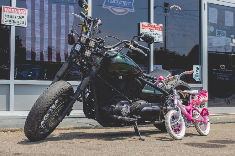 HD Transmission and Auto Repair will take a little time this summer to shift from typical auto repairs and help the community with kids' bike repairs.