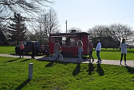 The Painted Pepper food truck serves customers last Friday at Bending Tree Estates.