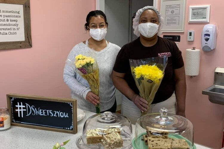 Christian Ream of Community Driven  spent time gifting flowers to random individuals and local business owners in Springfield, including D.Sweets, Cookies and Gifts.