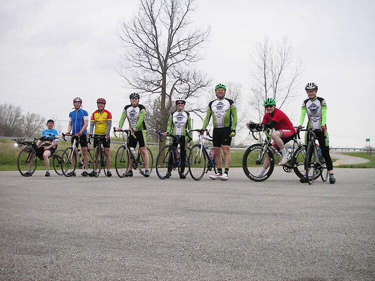 Cyclists take a break along the path that goes from West Liberty to Xenia.