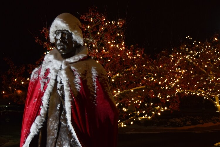 Even the statue of Oliver Kelly has become part of the fun, donning a Santa hat and festive cape.