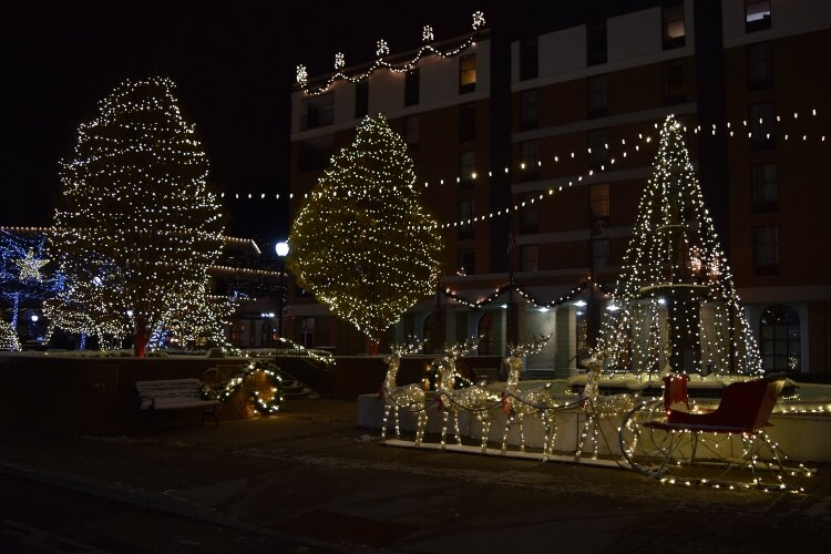 A sleigh and reindeer are part of the light display by the fountain on the esplanade in Downtown Springfield every evening through New Year.