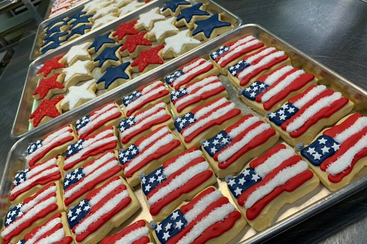 Cutout cookies, like these patriotic flags and stars, are among the many treats ordered from D.Sweets, Cookies & Gifts.
