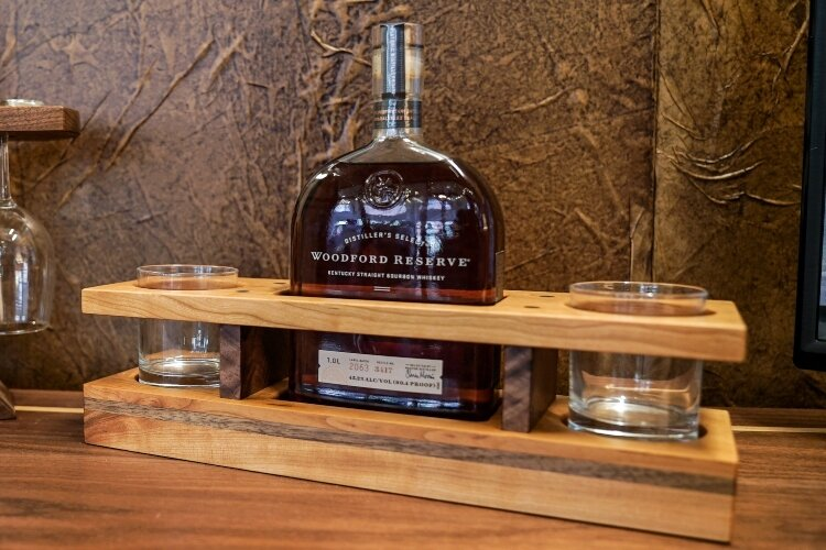 One of the smaller, popular items built and sold by Keener & Schultz Fine Woodworks is a holder to display a bottle of Woodford Reserve bourbon and glasses.