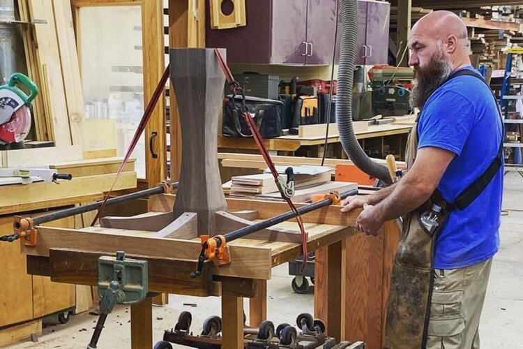 Mark Schultz, co-owner of Keener & Schultz Fine Woodworks, designs a custom piece in the workshop.