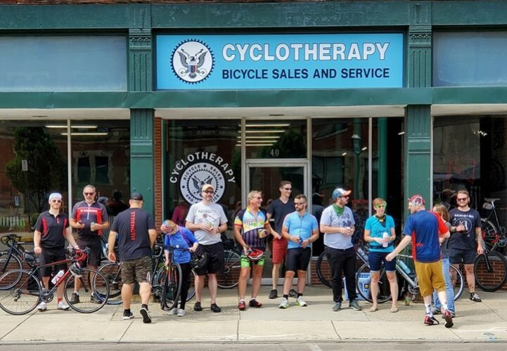 A group of cyclists gathered for a bike ride from Cyclotherapy to Yellow Springs and back.