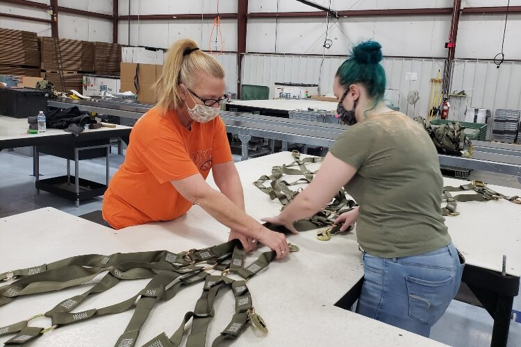TAC employees work to manufacture nylon cargo nets that the U.S. Air Force uses to transport materials around the world.